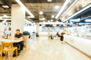 desfoque abstrato e centro de praça de alimentação desfocado da loja de departamentos foto