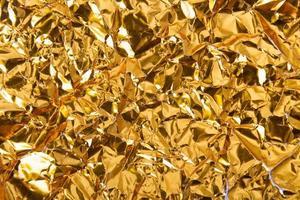 fundo de textura de papel dourado amassado foto