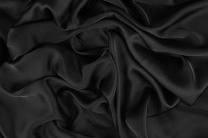 seda elegante suave ou textura de tecido de cetim luxuoso pode usar como plano de fundo do casamento. design luxuoso do plano de fundo. foto