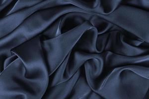 tecido de fundo. tecido têxtil escuro com textura e fundo de cortina padrão foto