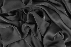 A textura lisa e elegante de seda ou cetim pode ser usada como fundo abstrato. design de fundo luxuoso foto