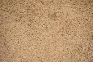 fundo de parede de casa de solo de argila marrom natural resistido foto