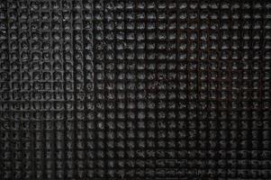 mosaico de superfície de ladrilhos de pedra negra molhados foto