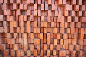 fundo de textura de parede de tijolo laranja acidentado foto