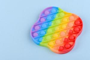 Brinquedo infantil colorido brilhante feito de silicone projetado para aliviar o estresse foto