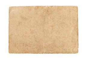 folha de papel velha isolada em um fundo branco. foto