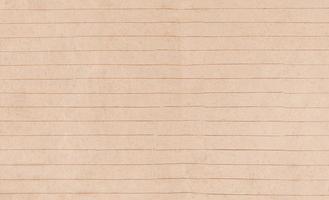 folha de papel bege velha em linha de fundo foto