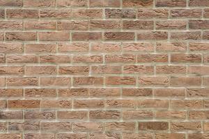 parede de tijolos decorativos marrom com textura envelhecida isolada closeup foto
