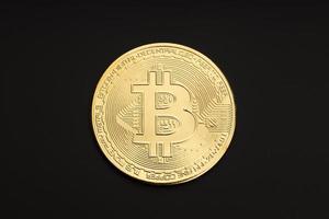 moeda de bitcoin isolada em fundo preto. criptomoeda. vista do topo foto