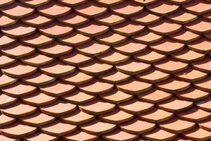 fundo laranja da textura do telhado do templo foto