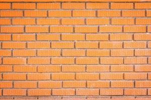 fundo de textura de parede de tijolo vermelho com bela textura nos tijolos foto