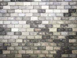 fundo antigo da textura da parede de tijolo de cores aleatórias em preto e branco. foto