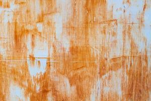 parede laranja com textura de metal enferrujado usada como plano de fundo foto