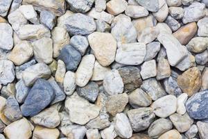textura de pedra pequena de close-up no chão, plano de fundo foto
