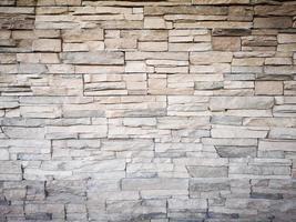 close-up de uma parede de tijolos de pedra cinza moderna usada como plano de fundo foto