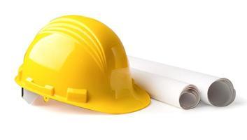 capacete de construção amarelo com planta, conceito de segurança de engenheiro. foto