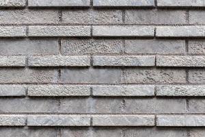 fechou a textura da parede de tijolo cinza. foto