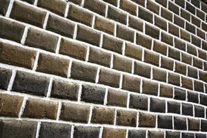velha parede de tijolos. textura de bloco de tijolo, parede externa foto