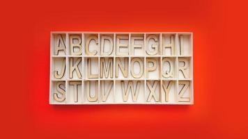 blocos do alfabeto de madeira com letras - caixa em um fundo vermelho foto