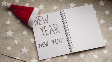 texto ano novo novo você no caderno de ano novo foto