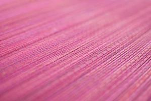 fundo de esteira de palha rosa de bambu foto
