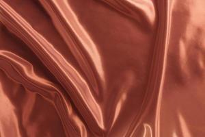 pano de seda de cetim ouro rosa abstrato para o fundo foto