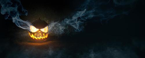abóbora de halloween em fundo escuro foto