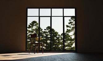 cadeira em frente a uma janela com a floresta ao fundo foto
