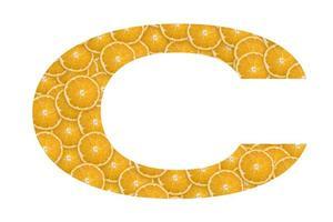 vitamina c escrita a partir de frutas cítricas foto