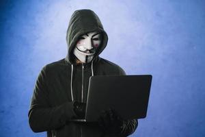 hacker com máscara anônima. resolução e bela foto de alta qualidade