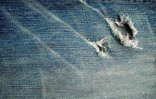 a textura do grunge estilo jeans azul foto