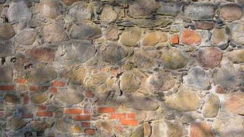 fundo de textura de parede de tijolo de pedra no castelo de Trakai na Lituânia foto