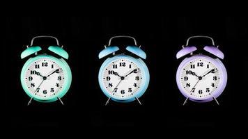 três despertadores coloridos em um fundo preto foto