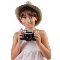 linda garota com uma câmera de filme foto