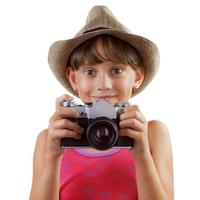 garota feliz com uma câmera de filme foto