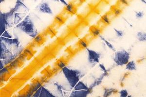 camada plana padrão de tie-dye colorido foto