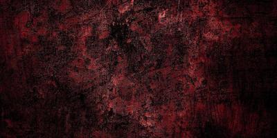fundo de terror vermelho e preto. grunge escuro textura vermelha concreto foto