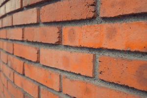 fundo de parede de tijolo antigo feito de textura de superfície de parede de tijolos foto