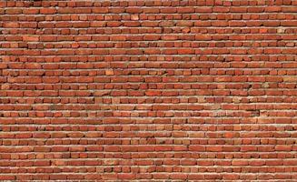 fundo close up da parede de tijolo vermelho foto