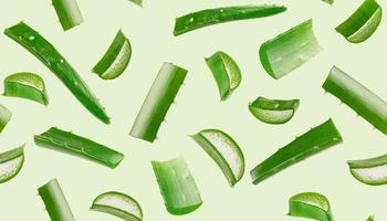 padrão sem emenda de aloe vera sobre fundo verde. foto