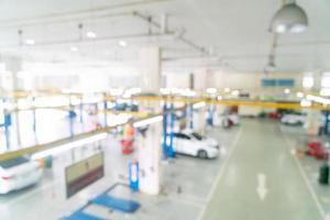 borrão abstrato serviço de carro de garagem para o fundo foto