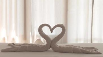 coração cisne toalha foto