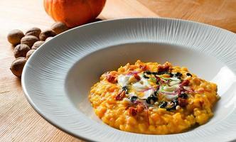 risoto de abóbora com tomate seco foto