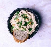 hummus delicioso foto