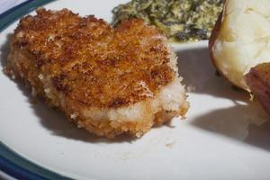 jantar de costeleta de porco à milanesa foto