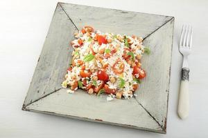 arroz cozido com tomate e grão de bico