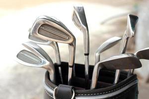 tacos de golfe de metal no saco foto