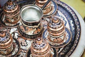 jogo de chá da decoração do artesão foto