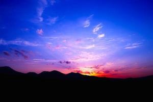 ... do pôr do sol foto