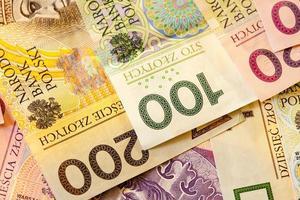 moeda de notas de zloty polonês como plano de fundo foto